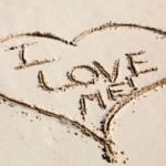 I love me written in sand